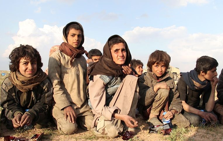 Uit de handen van IS geredde jezidi-jongens. Beeld AFP