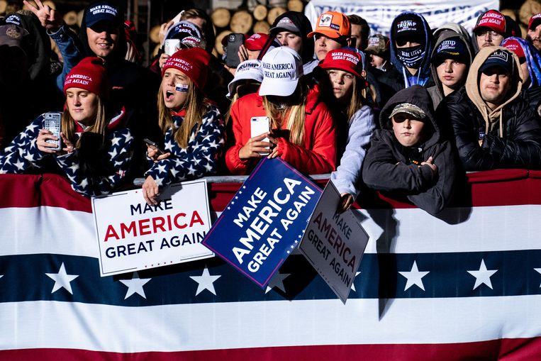 Trump-aanhangers tijdens een campaign rally in Duluth, Minnesota, op 30 september. Beeld NYT/ERIN SCHAFF