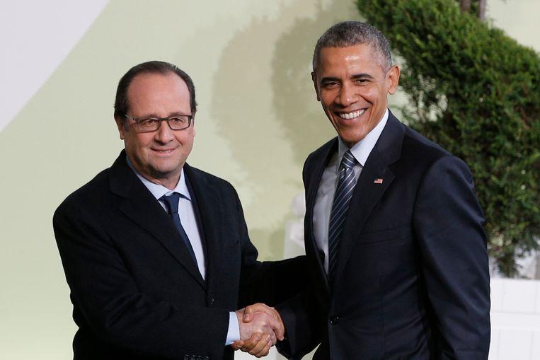 De Franse president Hollande en zijn Amerikaanse collega Barack Obama. Beeld AP