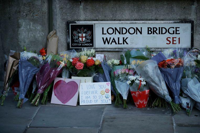 In Londen en Cambridge werden maandag wakes gehouden voor de slachtoffers van de aanslag.  Beeld AP