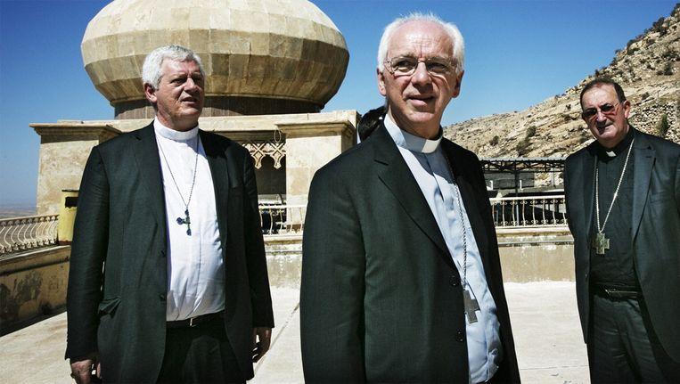 Bisschoppen Leon Lemmens, Jozef De Kesel en Guy Harpigny. Beeld Tim Dirven