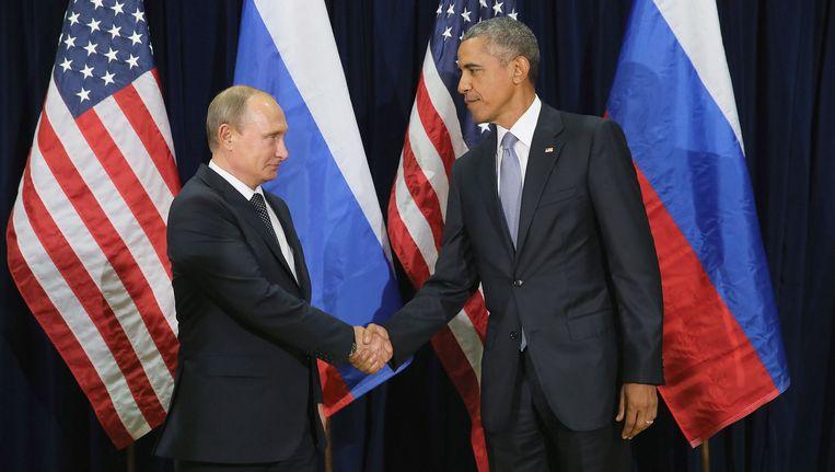 President Valdimir Poetin en president Barack Obama in New York op 28 September 2015. Beeld Getty Images