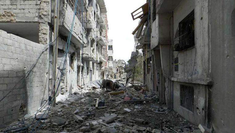 Het kapotgeschoten Homs, op een foto van 22 mei. Beeld afp