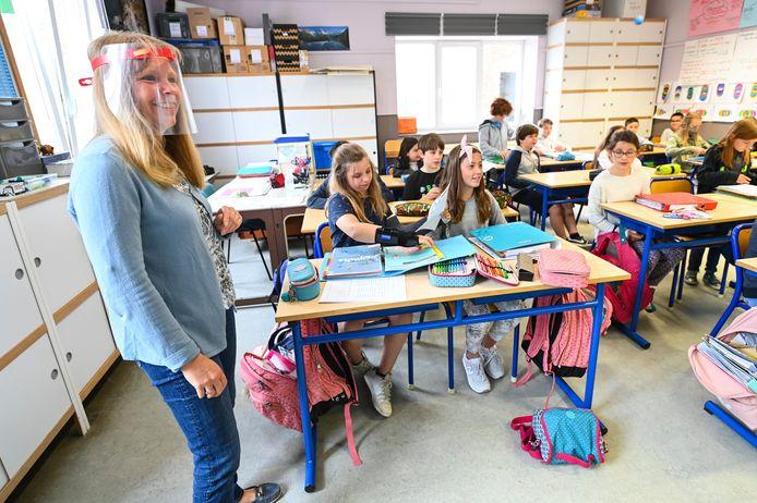 Stockbeeld: kinderen op school.