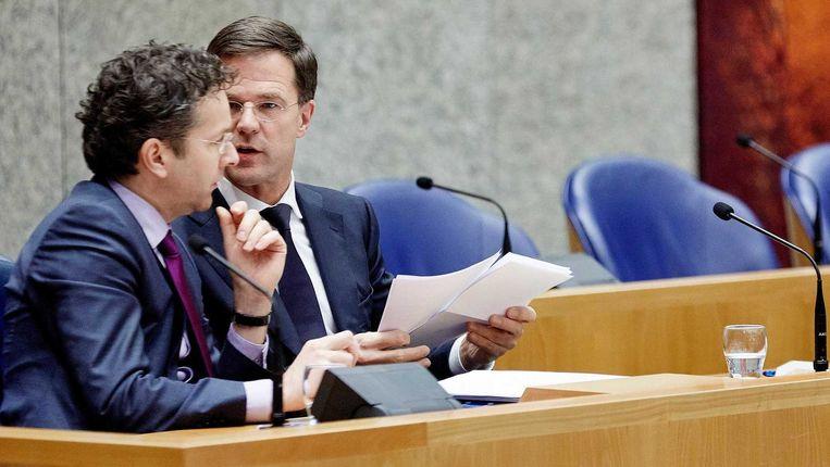 In het vertrouwelijke conceptadvies aan het kabinet zit één grote adder onder het gras voor premier Rutte en minister Dijsselbloem van Financiën: werknemers mogen het niet merken in hun portemonnee. Beeld anp