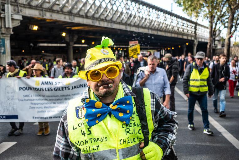 De gele hesjes, de grootste protestbeweging sinds 1968, komen sinds november 2018 op straat. Hoewel ze voor velen een donderslag bij heldere hemel waren, kookten de potjes al langer over op Facebook in zogenoemde groupes de colère. Beeld Joris Van Gennip