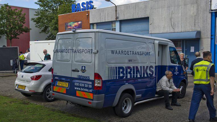 Technisch onderzoek na de vorige overval op een geldtransport van Brinks, in Amsterdam. © ANP Beeld