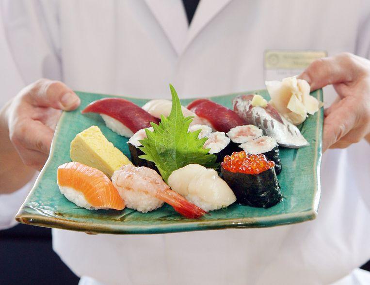 De actie is inmiddels afgelopen, de drukte op de overheidskantoren nog niet. De meeste sushi-jagers willen de naam 'Zalm' niet voor altijd houden Beeld AFP