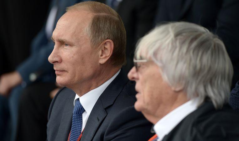 Poetin naast Ecclestone Beeld AFP