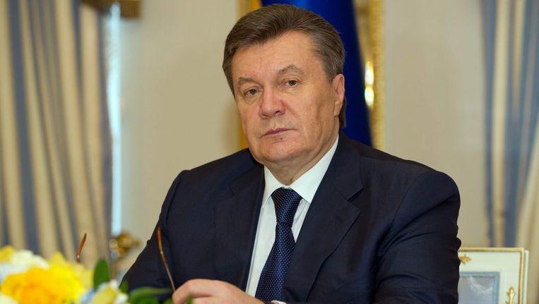 Er is een inval gedaan in het kantoor van de zoon van Janoekovitsj. De zoon van de hier afgebeelde president zou zich ook schuldig hebben gemaakt aan witwassen. Beeld epa