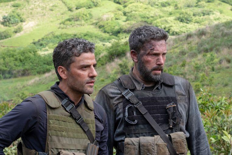 Oscar Isaac (l) en Ben Affleck (r) in de nieuwe Netflix-film 'Triple Frontier'. Beeld AP