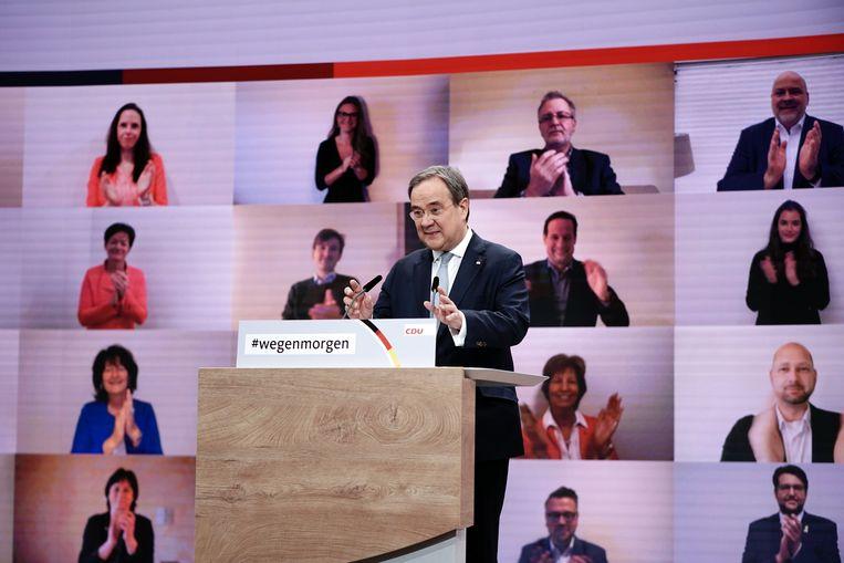 De nieuw gekozen CDU-leider Armin Laschet tijdens de partijconferentie.  Beeld Michael Kappeler/dpa