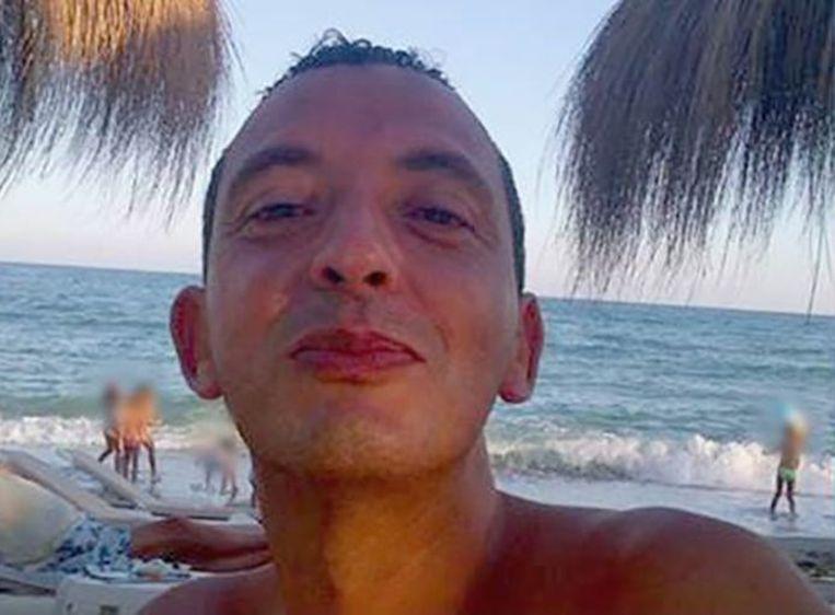 Taghi – hier op een foto van 20 jaar geleden – wist jarenlang uit handen van de politie te blijven. Tijdens zijn vlucht verbleef hij onder meer in Marokko, Zuid-Amerika en Dubai, waar hij als een koning leefde. Beeld Politie