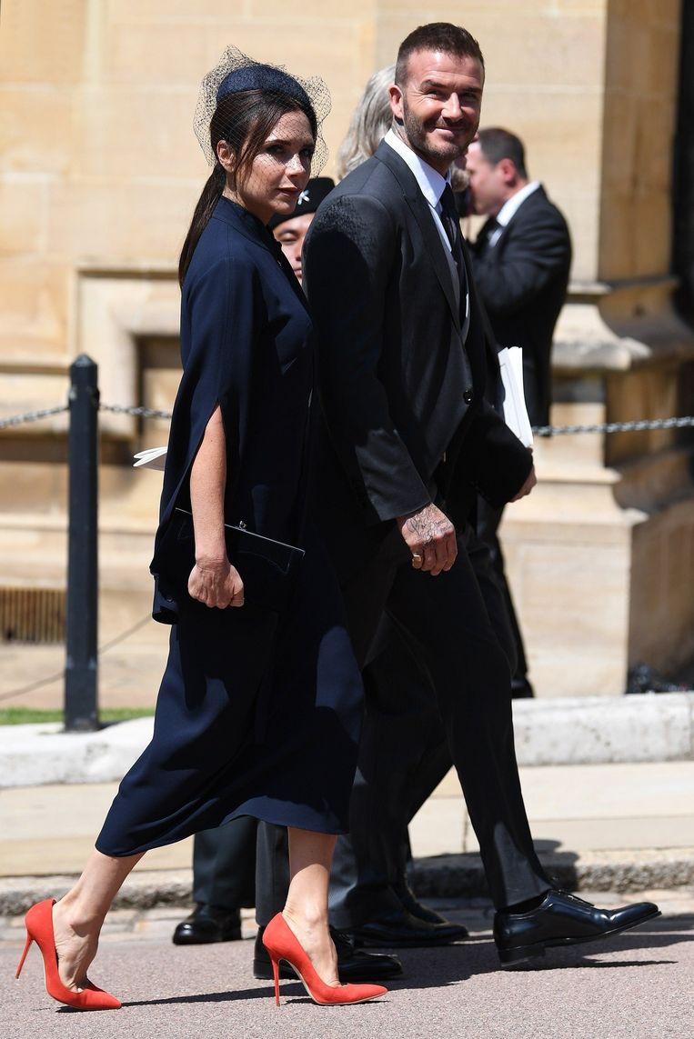 Victoria Beckham en haar man David Beckham tijdens het koninklijke huwelijk op 19 mei.