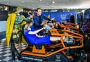Koningin Maxima en prinses Ariane krijgen uitleg van ex-coureur Robert Doornbos over de E-Race tijdens Koningsdag op de High Tech Campus.