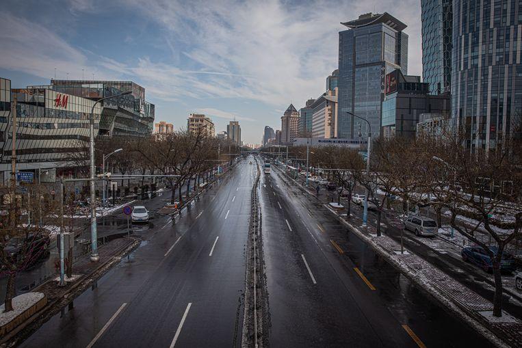 Lege straten in de Chinese stad Wuhan. Beeld EPA