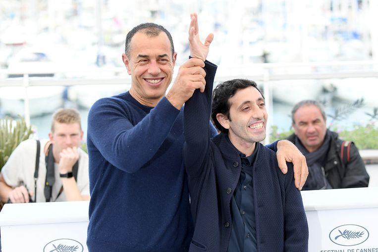 Matteo Garrone (links) en acteur Marcello Fonte bij het filmfestival in Cannes in mei 2018. Beeld null