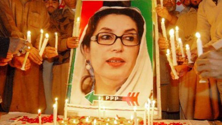Aanhangers van de partij van Benazir Bhutto rouwen om haar dood. ANP Beeld