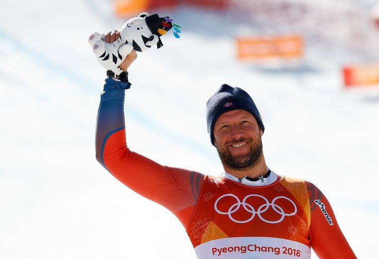 Aksel Lund Svindal  viert zijn overwinning  alpineskiën op de Olympische Spelen van PyeongChang in 2018. Beeld REUTERS