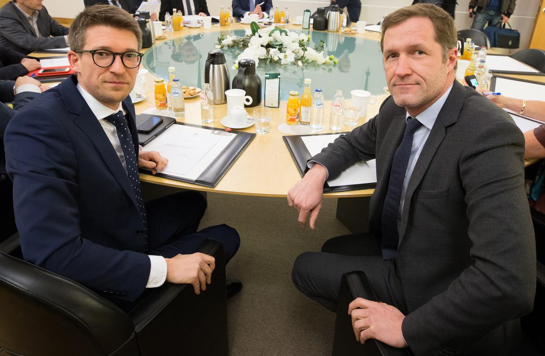 Minister van Werk Pierre-Yves Dermagne (PS) en PS-voorzitter Paul Magnette. Beeld BELGA