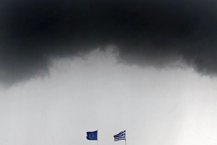 Onweerswolken boven Athene, afgelopen donderdag. Beeld REUTERS