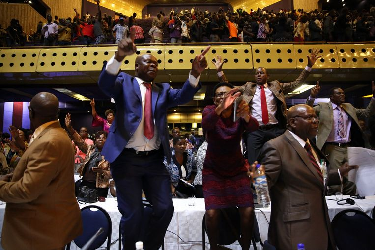 People react after the speaker of the House of Assembly Jacob Mudenda read a letter sent to him by Zimbabwean President Robert Mugabe on his resignation at the Harare International Conference Centre in Harare, Zimbabwe. Beeld EPA