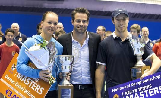 Kiki Bertens en Raemon Sluiter in 2013 bij de Masters. Rechts Igor Sijsling.