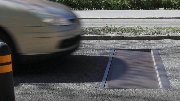 Geen drempel maar een beweegbare put in de weg.