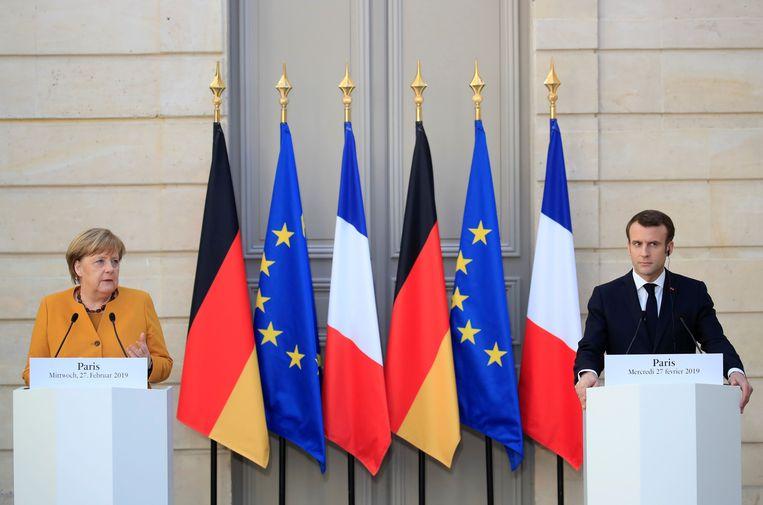 De Duitse bondskanselier Angela Merkel met de Franse president Emmanuel Macron.