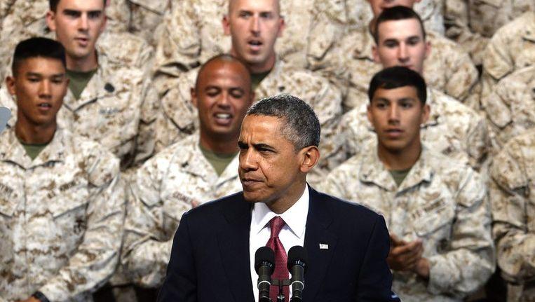 Obama spreekt mariniers toe over een mogelijke 'kleinschalige mililtaire aanval' op Syrië. Beeld epa