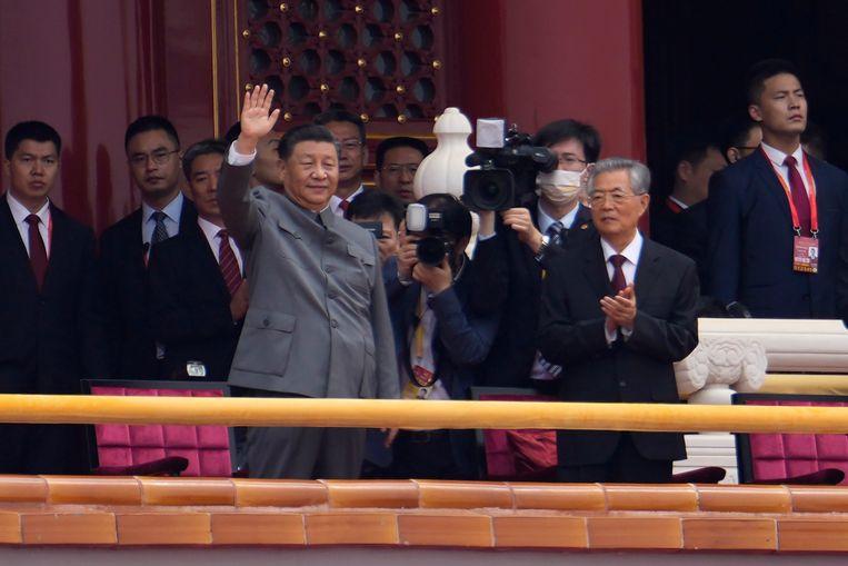 Chinese President Xi Jinping naast voormalige president Hu Jintao (rechts). Beeld AP