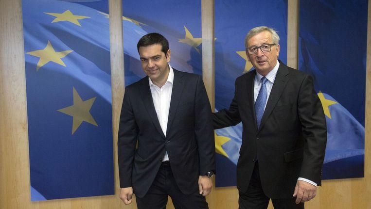 De Griekse premier Tsipras en Europees Commissievoorzitter Jean-Claude Juncker. Beeld AP
