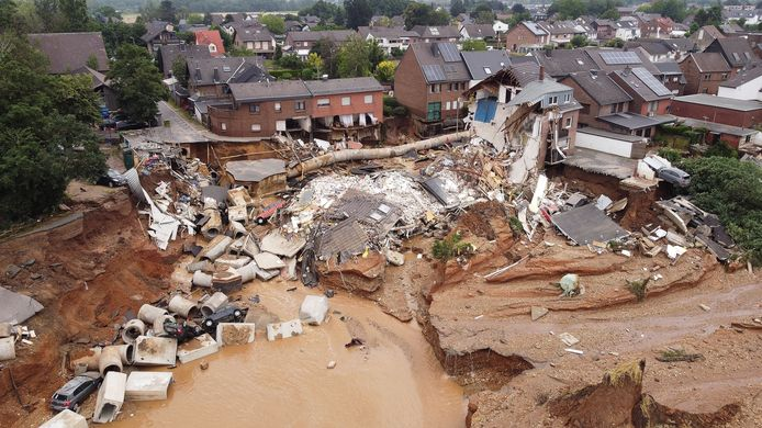 The natural disaster has left holes in Erfstadt, where rubble from houses is piled up with household goods, cars and sewer pipes.