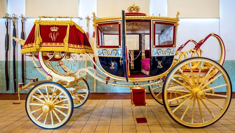 De Glazen Koets is uitgevoerd in drie kleuren: rood, wit en blauw. De rest is goud. Zo symboliseert het rijtuig de Nederlandse vlag Beeld Raymond Rutting