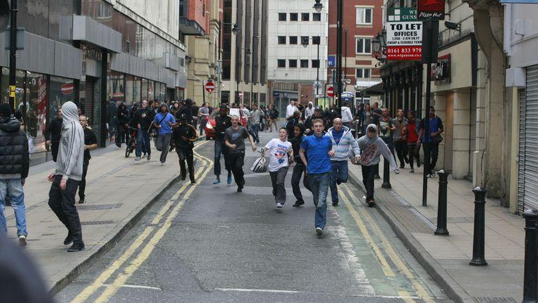 Relschoppers in Market Street in Manchester. Beeld getty
