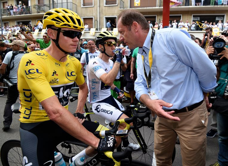 Tourbaas Christian Prudhomme (r) naast Chris Froome