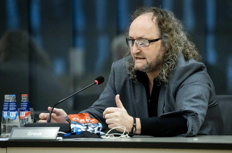 Dion Graus (PVV) in de Tweede Kamer tijdens een debat over een voorstel om de verplichte negatieve coronatest die reizigers moeten overleggen voor zij uit een risicogebied naar Nederland reizen, een extra wettelijke basis te geven.  Beeld ANP