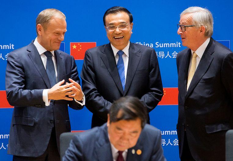 EU-president Donald Tusk, Chinese premier Li Keqiang en Europese Commissievoorzitter Jean-Claude Juncker. Beeld AP