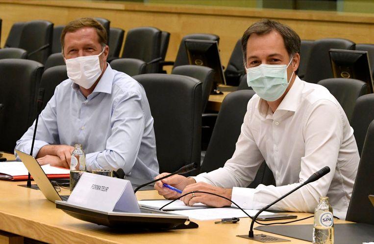 Paul Magnette en Alexander De Croo. Gunnen de liberalen de socialist het premierschap? Beeld Photo News