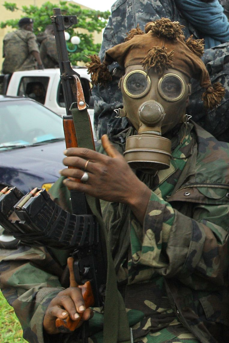 A pro-Ouattara fighter of the FRCI (Republican Force of Ivory Coast), wearing a gas mask, prepares for the so-called