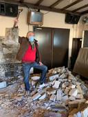 Toon van den Broek bij de resten van de gesloopte binnenmuren van zijn café.