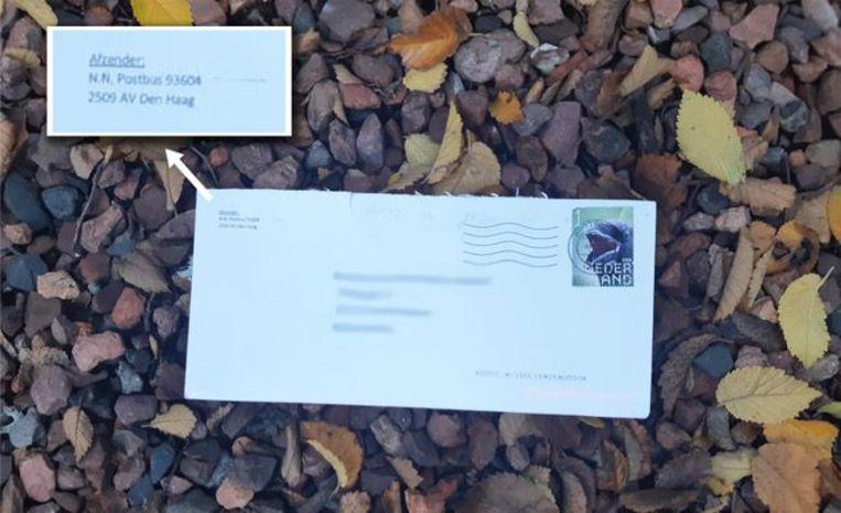 Een van de poederbrieven die werden bezorgd, met fictieve afzender de Nationale-Nederlanden in Den Haag.  Beeld ANP