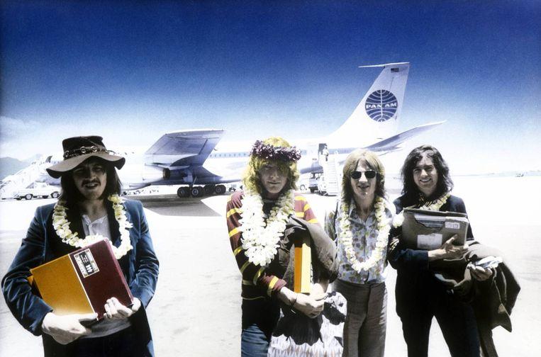 John Bonham, Robert Plant, John Paul Jones en Jimmy Page komen in '69 aan in Honolulu met de 'Led Zeppelin II'-mastertapes. Beeld Redferns