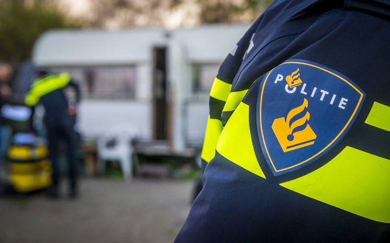 Politie tijdens een inval. Beeld ANP
