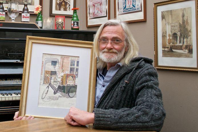 Fons Teijssen met een van zijn aquarelwerken.