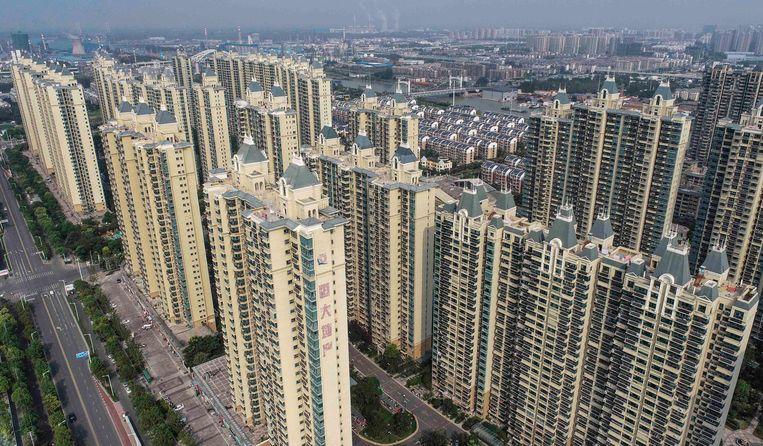 Huizencomplexen ontwikkeld door het concern Evergrande in de oostelijke Chinese provincie Jiangsu. Beeld AFP