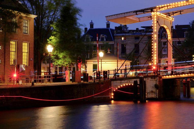 Een rode draad van 6,5 km Beeld Amsterdam Light Festival