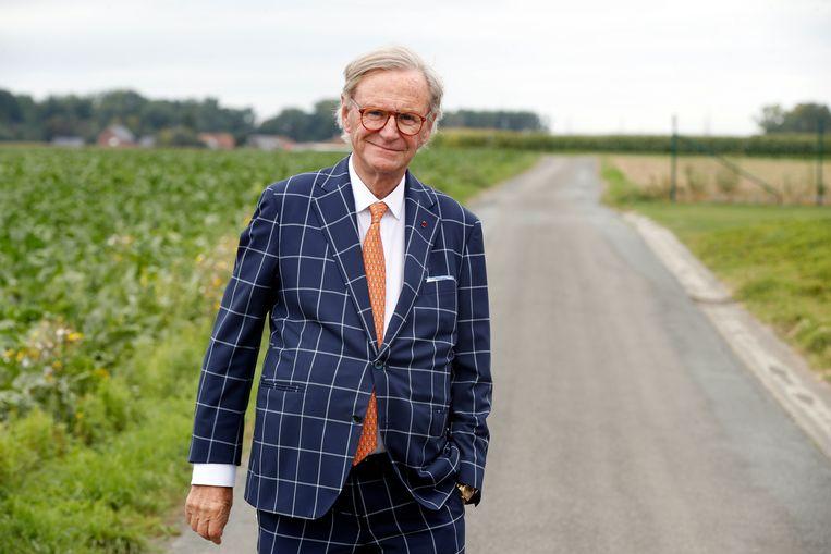 Met de glimlach zou Willy Naessens in deze abnormale crisis meer belastingen betalen. Beeld Kristof Ghyselinck