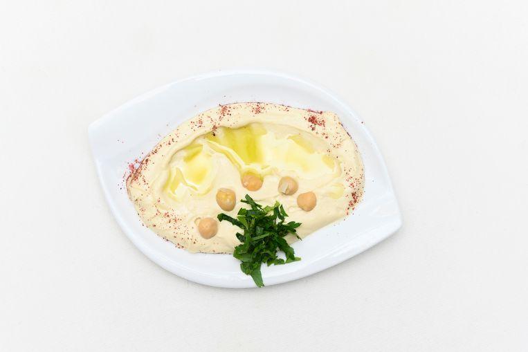Een van de bordjes hummus. Beeld Els Zweerink
