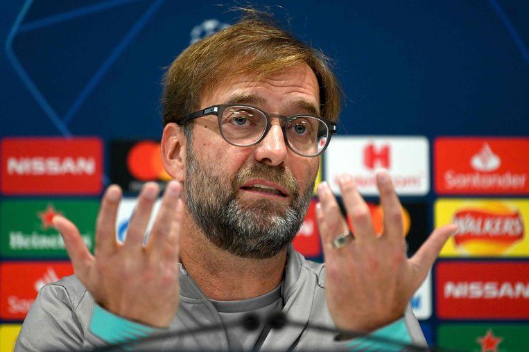 De excentrieke Jürgen Klopp op de persbabbel voor Liverpool-Genk. Beeld AFP